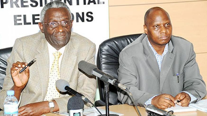 NEC Chairman, Chrysologue Karangwa (L)  announced the results yesterday as Executive Secretary, Charles Munyaneza looks on. (Photo / J. Mbanda)