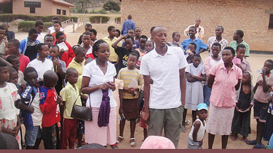 Orphans with their care takers at SOS primary school yesterday (Photo; E. Mutara)