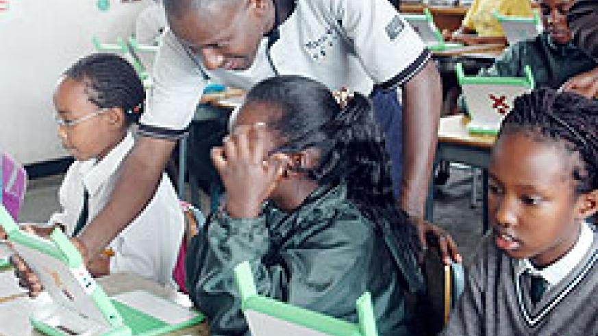 Primary School pupils with laptops acquired under the One Laptop Per Child Programme. Teachers will  soon also benefit from a similar programme (File Photo)