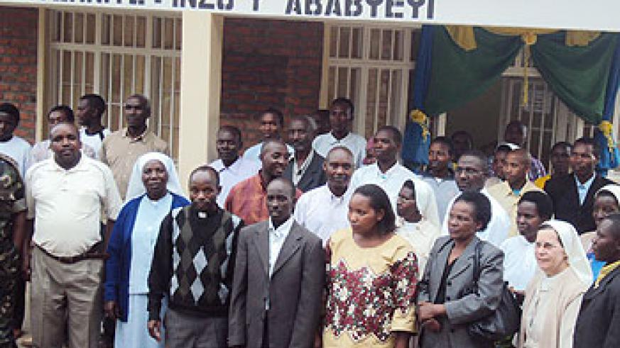 Officials pose for a group picture at Busogo maternity block after its provisional opening. (Photo B Mukombozi)