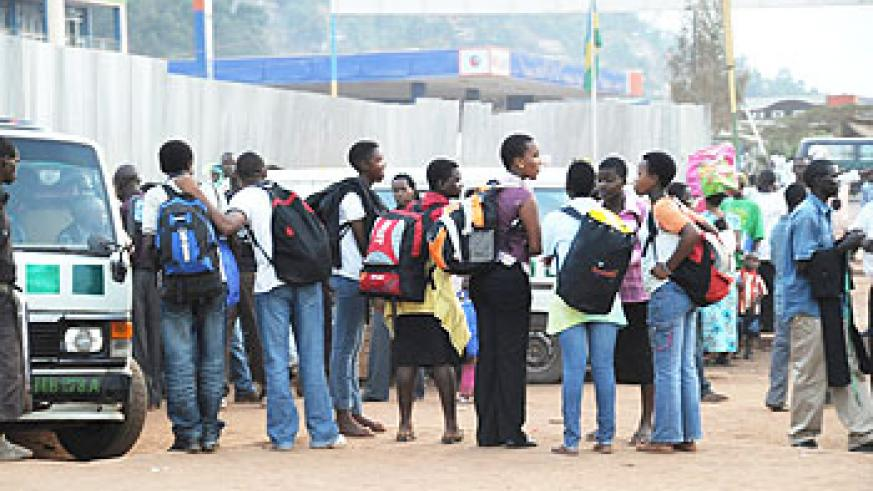 Students waiting to board busses to school, yesterday after a two-week holiday (Photo F Goodman)