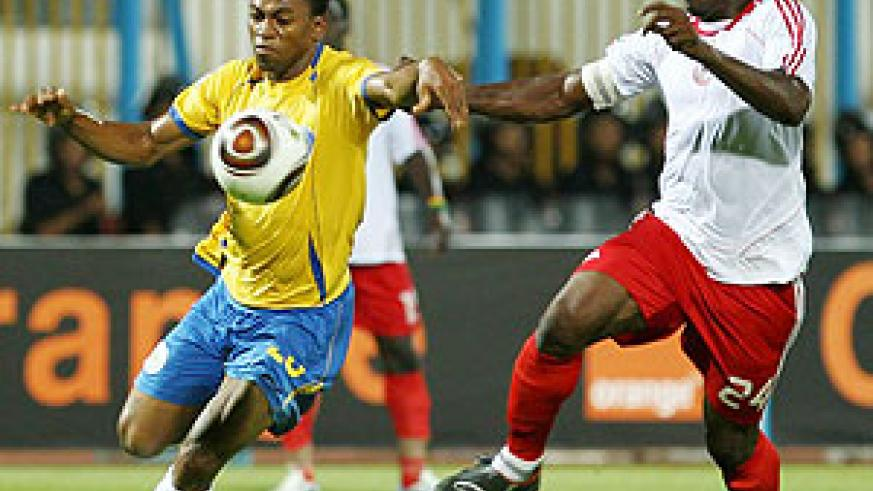 Nigerian player Heartland FC Derick Amadi (R) challenges Edwin of Ismailiy of Egypt during their African Champions League football match in Ismailia.