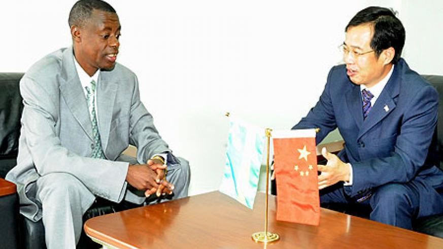 Defence Minister James Kabarebe (L) with Chinese Ambassador to Rwanda, Sun Shuzhong. (Photo J Mbanda)