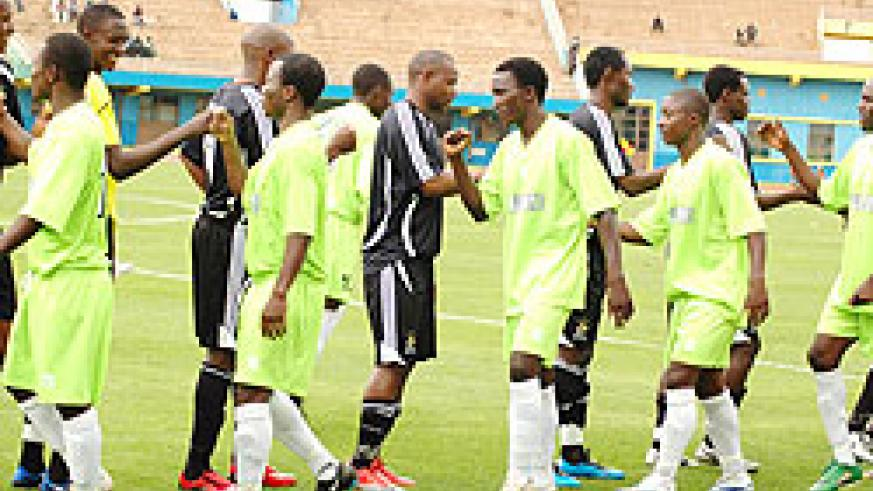 APR and KIYOVU players greet each other before last season's game at Amahoro stadium. The two rivals meet today in the second semi finals of pre-season Primus cup. (File photo)