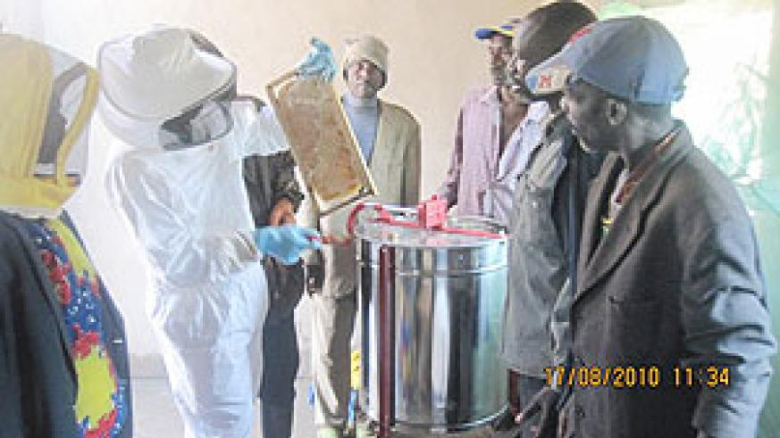 Cooperative members admiring the new  honey extractor machine . (Photo: D. Ngabonziza)