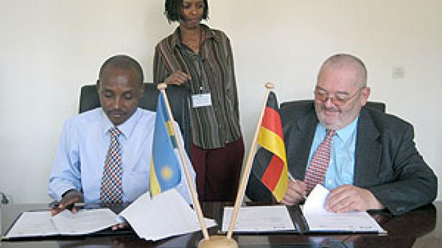 RBS boss Dr. Mark Bagabe (L) and Thomas Bedenbecker of GTZ signing the MoU yesterday (Courtesy photo)