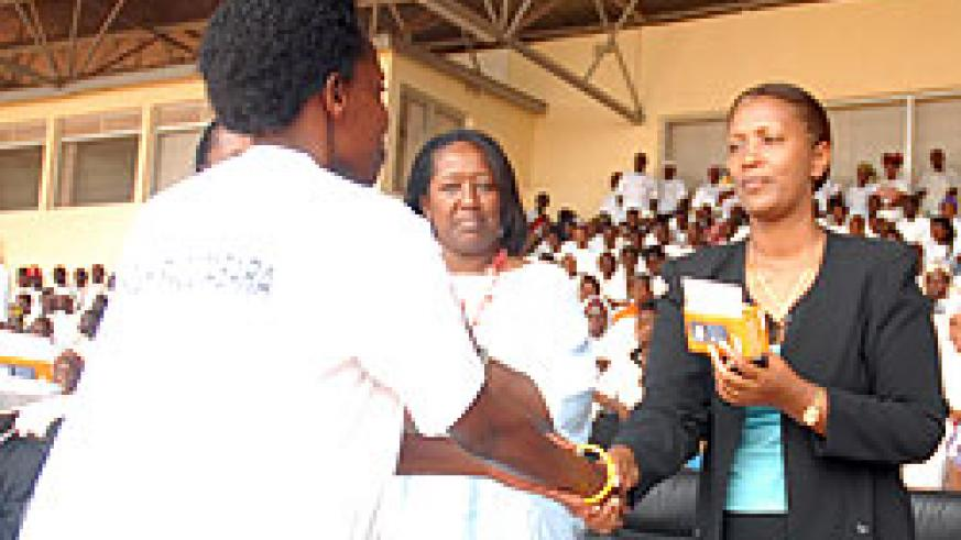 KCC's deputy Mayor, Jeanne d'Arc Gakuba, handing over a phone to a health worker recently (File photo)