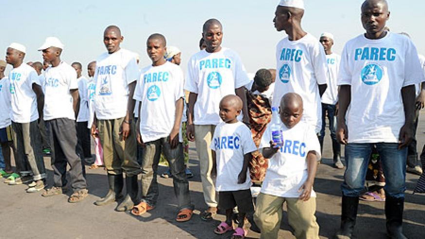 Some of the former FDLR comabatants and rtheir families on arrival at Kanombe Airport Yesterday