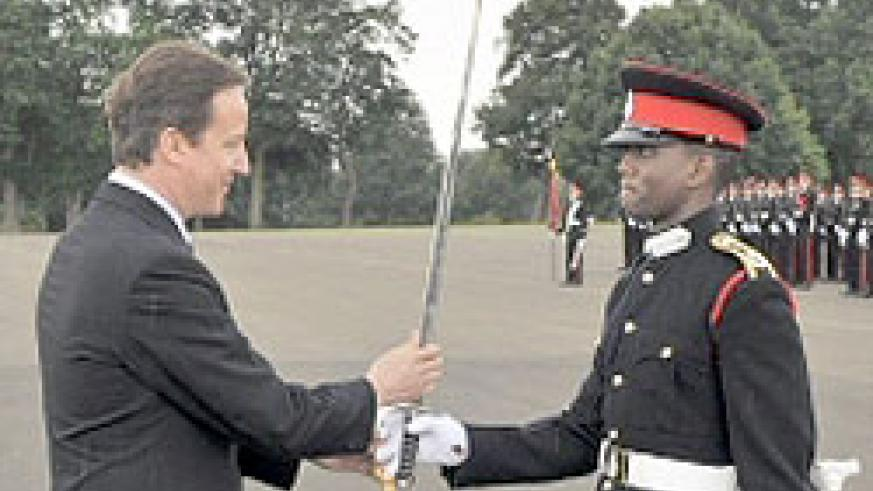 Sandhurst's graduate Ramsey Simba (R) with British Premier David Cameron during the pass out (Courtesy photo)