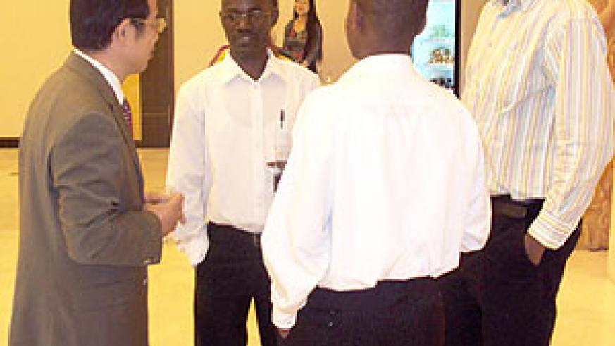 The Chinese Ambassador speaking to some of the students (Photo: C. Kwizera )