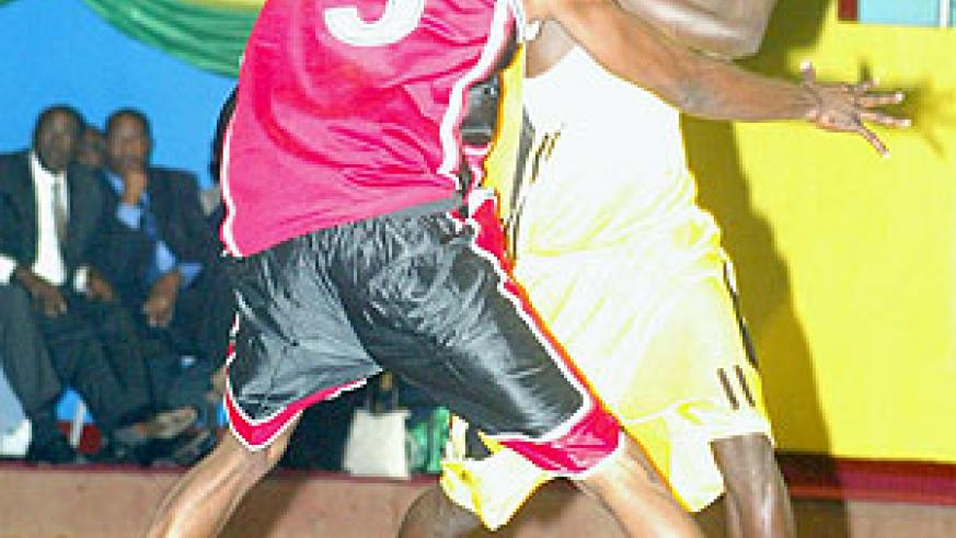 Former CSK player Fiston Muhire (with the ball) tries to hold off a Burundian player during last year's  Zone V championships.