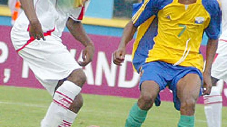 Migi (R) during last year's Africa Youth Championships. The midfielder flew to Germany last night. (File Photo)