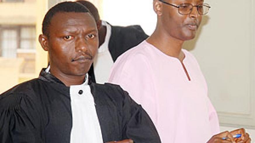 Deo Mushayidi (L) appeared in court yesterday.