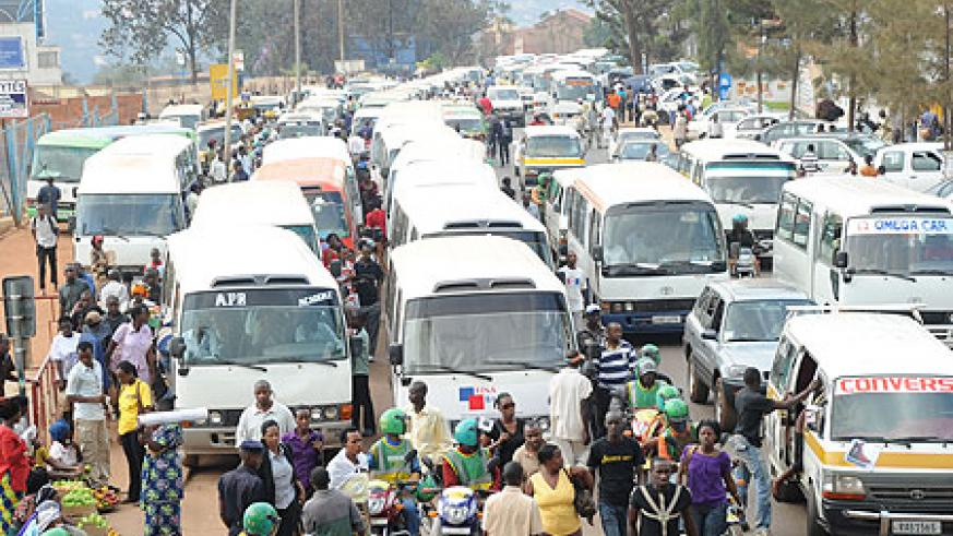 Commuter transporters queue up to pick passengers at Kwa Rubangura terminal. Passengers have expressed mixed feeling on new rates (File Photo)