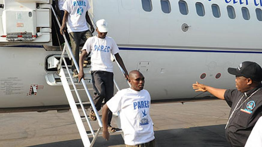 Some of the returnees disembarking from a plane at Kigali International Airport (Photo;J. Mbanda)