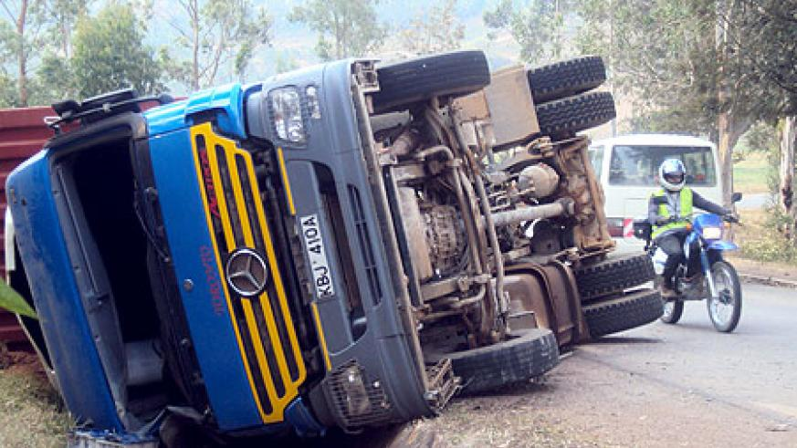 The overturned truck that was involved in an accident along the Butare Kigali highway. (Photo By D. Nzigiyimana)