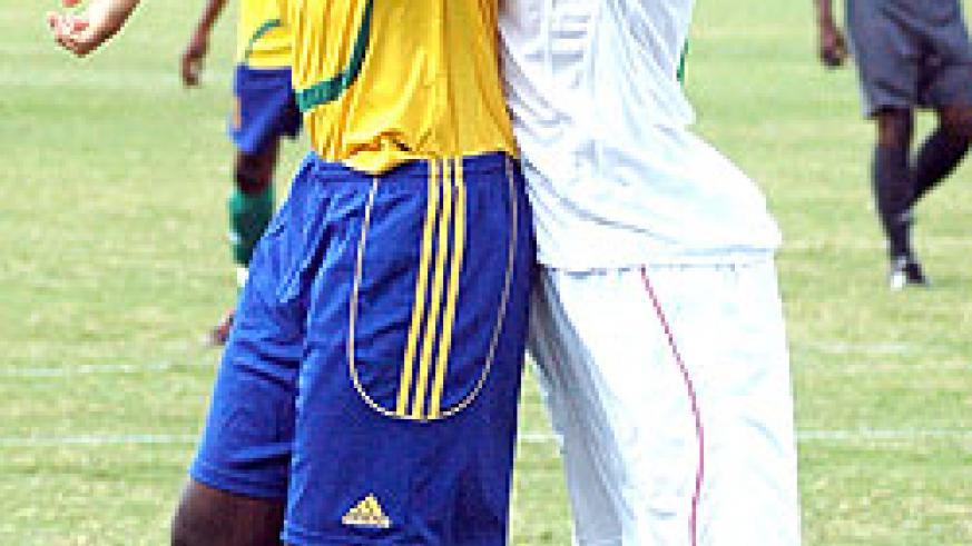 TIRED MUSCLES:  Karekezi shoulders off an Algerian defender during a 2010 African Nations Cup qualifier. (File Photo)
