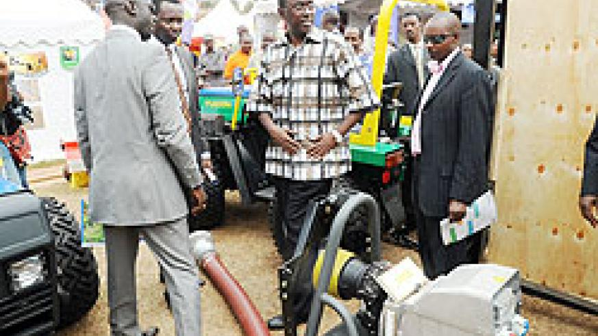 Prime Minister Bernard Makuza (C) being shown around the Expo grounds yesterday (Photo: J. Mbanda).