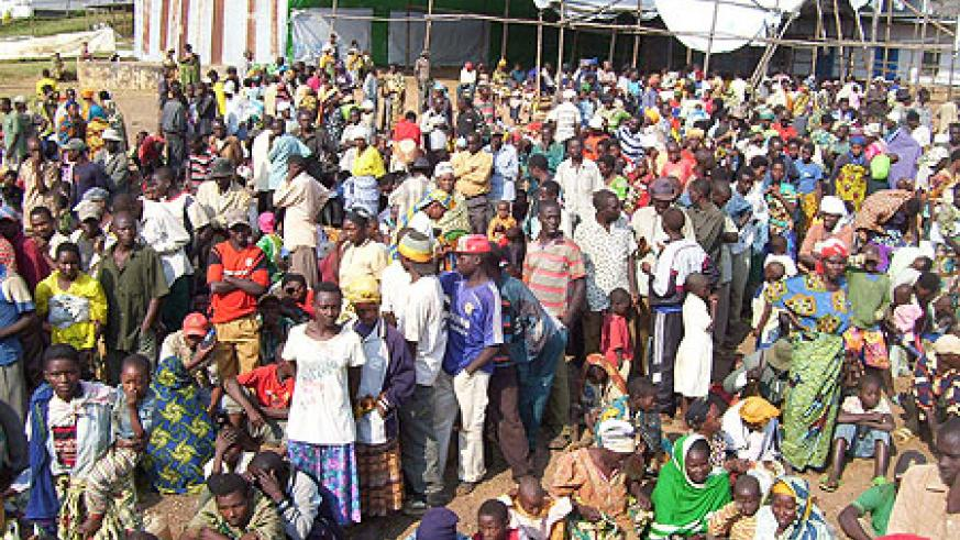 Part of close to 2000 returnees from Uganda awaiting registration exercise at Gicumbi transit camp in July. (Photo A.Gahene)