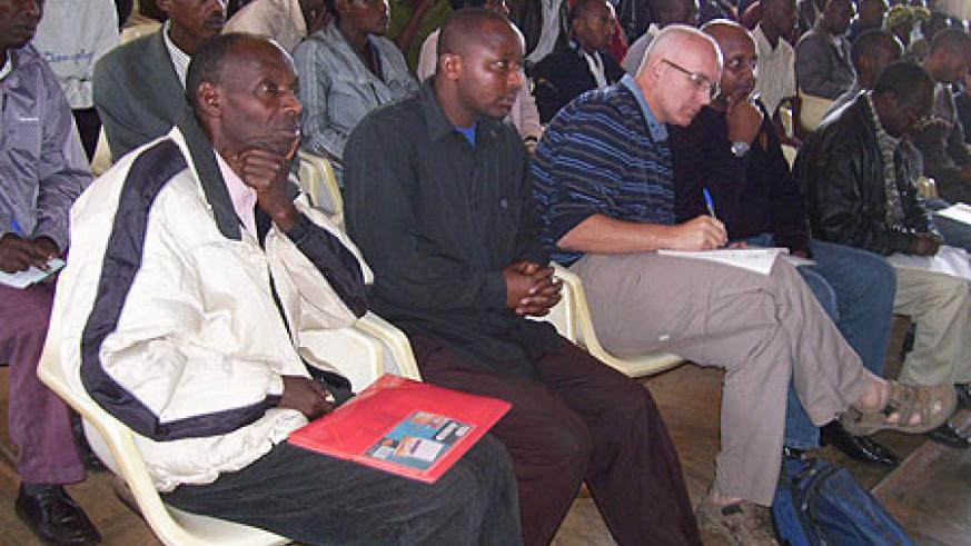 Refugee teachers in a meeting with district authorities and JRS on Tuesday. (Photo  A.Gahene)