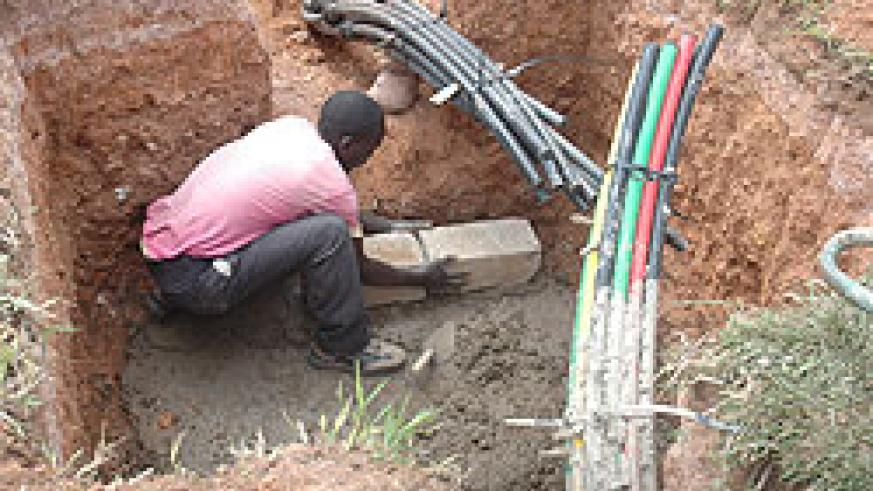 A Man lays Fibre Optic cables. Government has announced that works on  the rollout have reached 50 percent (File Photo)