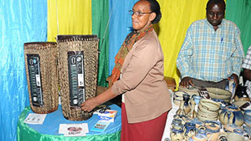 local business woman shows off a creatively made radio at the ongoing International Trade Fair (Photo; J. Mbanda)