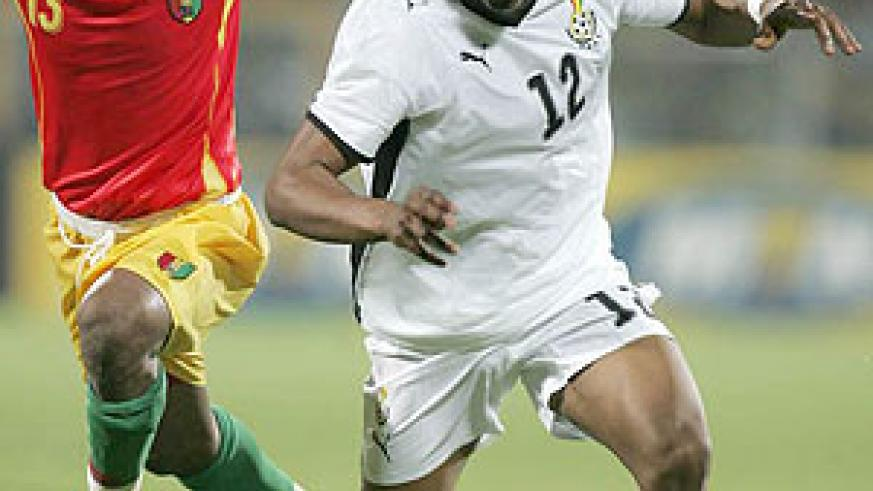 Ghana's Andre 'Dede' Ayew fights for the ball with Guinea's Mohamed Sacko (L) during the 2008 Nations Cup in Accra. (Net photo)