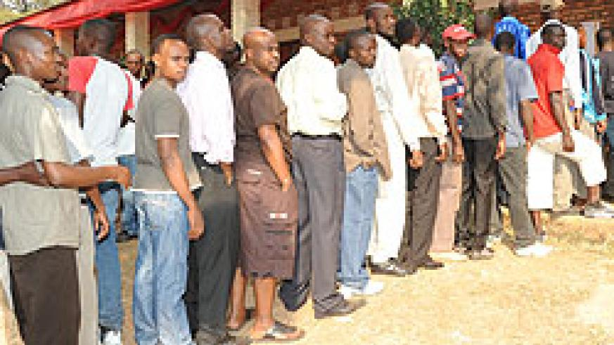 People queue up to vote in the just-concluded presidential polls. NEC plans to conduct local leaders polls early next year (File Photo)