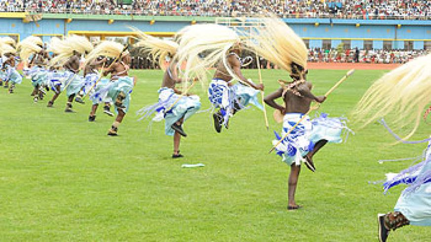 Urukerereza's male dancers take on the stadium with their brilliant traditional dance moves.