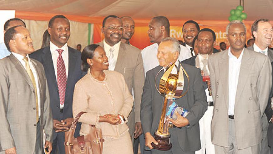 The Minister of Trade, Monique Nsazabaganwa in a group photo with JC Alles of SORWATHE,