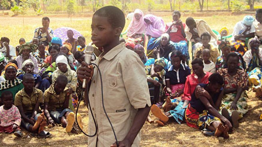 Francois Nshimiyimana, 16, one of the ambandoned children, narrating his ordeal, before an astonished crowd(Photo S. Rwembeho)