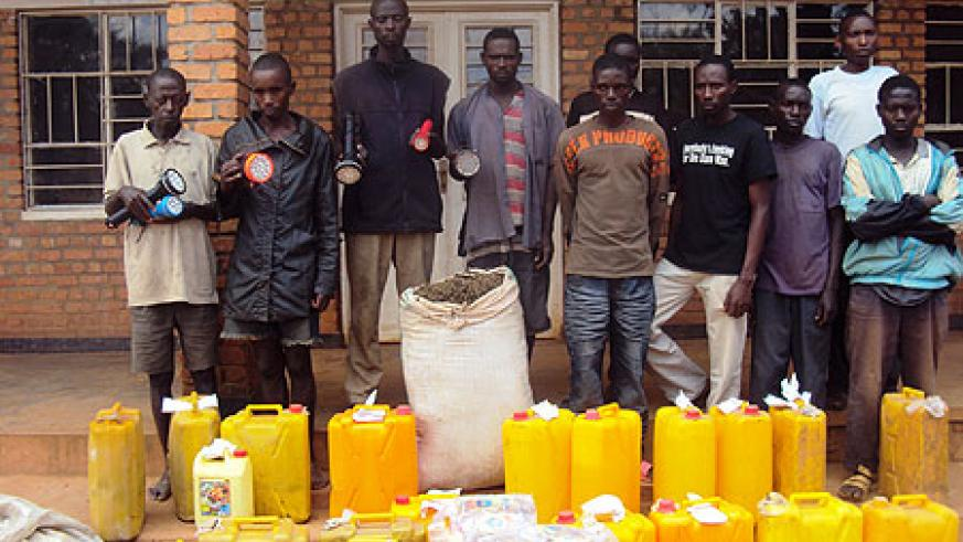 Poachers (with torches) and drug dealers(R) being paraded at Rukara Police Station (Photo; S. Rwembeho)