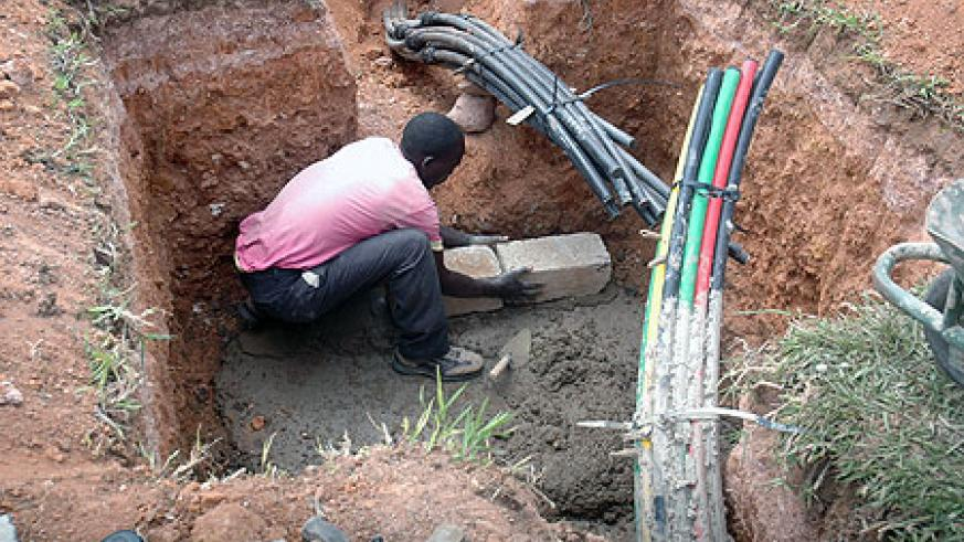 A man lays Fibre Optic cables. Several of these projects that are already underway will spur development of the country (File photo)