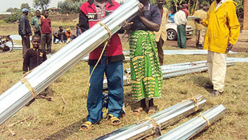 At least 37 residents of Rugarama sector received iron sheets for constructing better houses. (Photo / B. Mukombozi)
