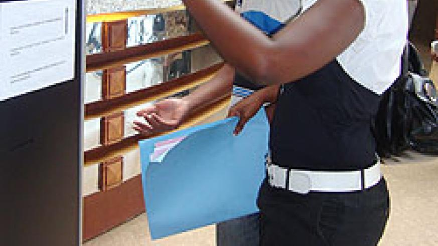 Taxpayers using the queue management system at RRA headquarters (Courtesy photo)