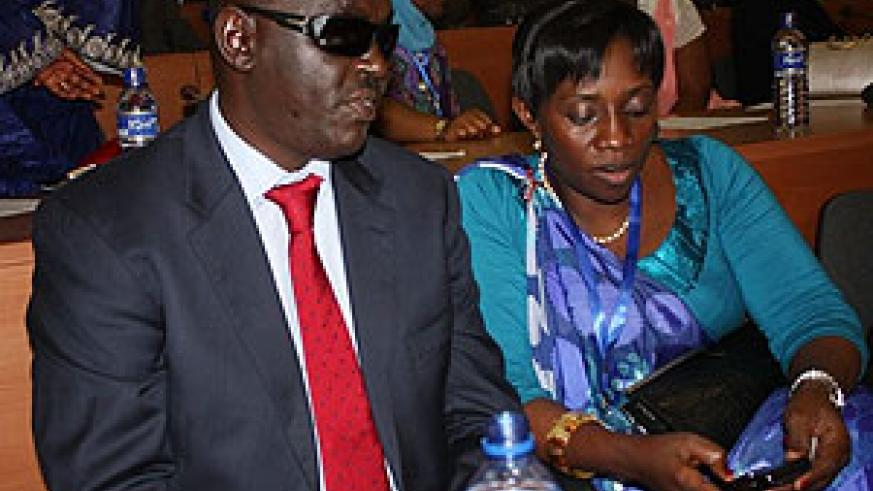 EALA member Dr. James Ndahiro with another EALA member during the session yesterday in Bujumbura (Courtesy photo)