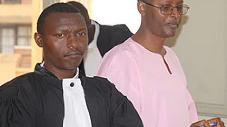 SENTENCED TO LIFE; Deo Mushayidi (R) appearing before court recently (File photo)