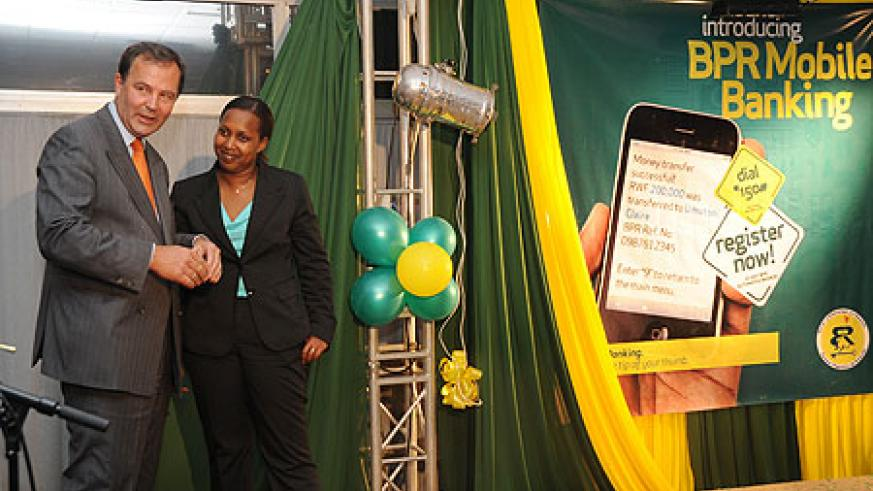 Ben Kalkman, BPR CEO and Pichette Sayinzoga, PS Ministry of Finance during the launch (Photo T. Kisambira)