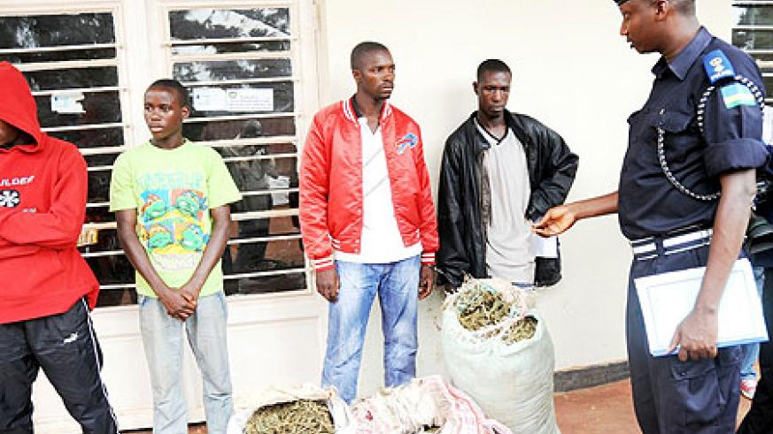 Police Spokesman Supt. Eric Kayiranga parading the suspected drug traffickers at Nyarugenge Police Station (Photo; J. Mbanda)