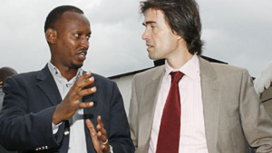 CAPTION: Ferwafa's CEO Jules Kalisa (L) and Bralirwa Commercial Director Alexander Koch (R) during the signing of the league sponsorship deal in March. (File photo)