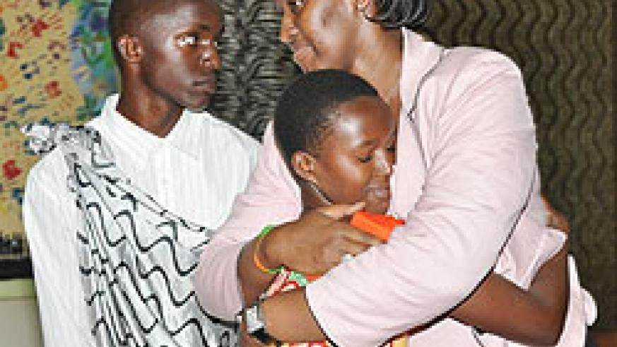 First Lady, Mrs. Kagame embraces one of the orphans at Agahozo Shalom Youth Village, yesterday. (courtesy photo)