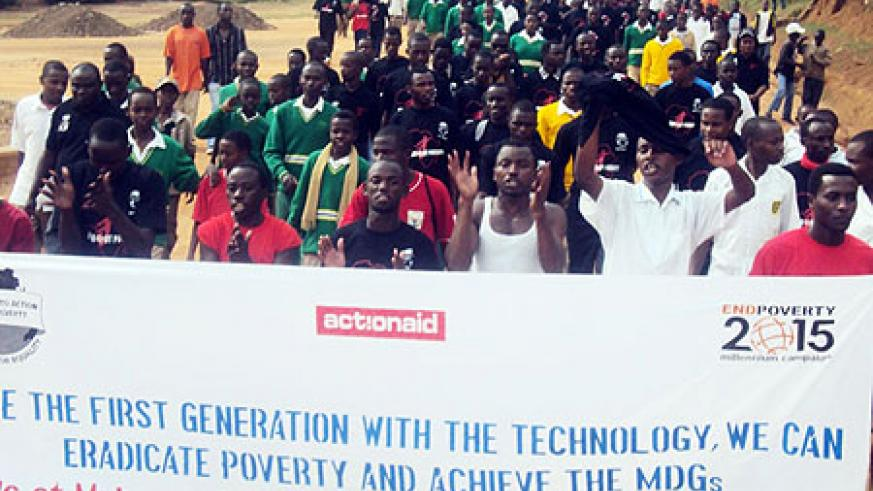 Students march through Muhanga town to raise awareness on the MDG's (Photo: D.Sabiiti)