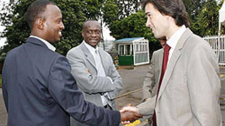 Ferwfa's CEO JUles Kalisa (L) and Bralirwa's Commercial Director Alexander Koch (R). Looking on in the middle is Sports minister Joseph Habineza. (File photo)