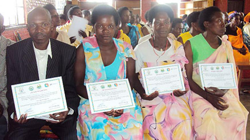 Excited farmers receive certificates after completion of the training.Photo B Mukombozi