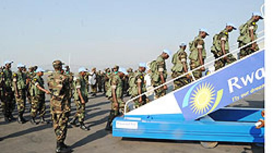 A cross section of RDF soldiers boarding a plane for Khartoum at Kigali Airport yesterday (Photo; T. Kisambira)