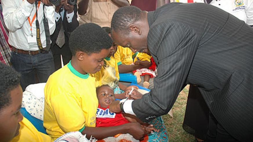 Health Minister Dr. Richard Sezibera taking part in the Immunisation exercise in Gashora recently.(File photo)