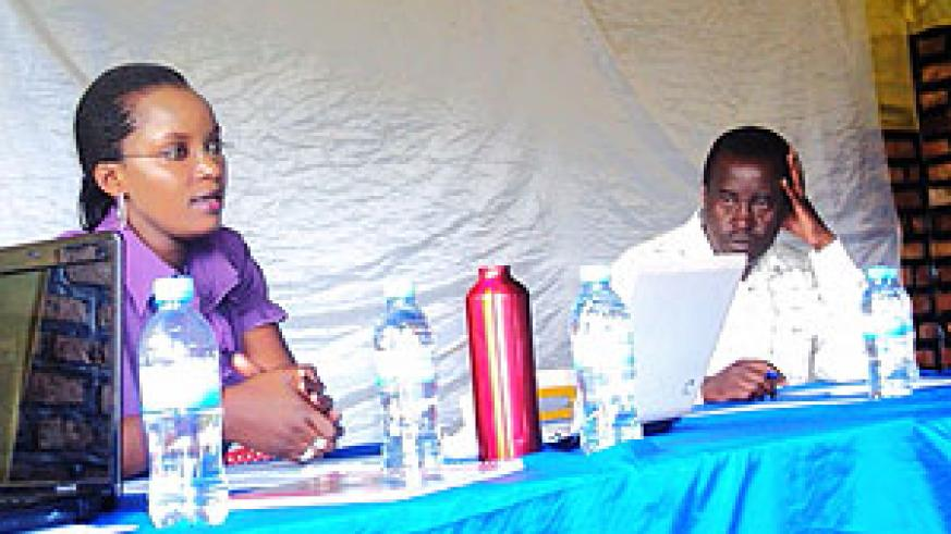 Dr. Karamaga (R) and Denise Uwera (L) during the meeting. (Photo S. Rwembeho)