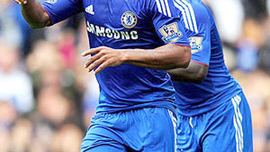 Malouda celebrates his second goal and Chelsea's fourth against Blackpool last weekend.