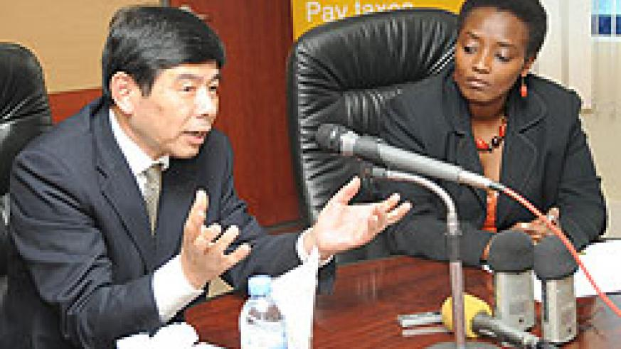 The Secretary General of the World Customs Organization Kunio Mikuriya (L) addresses the press as RRA's Mary Baine looks on (Photo; J. Mbanda)