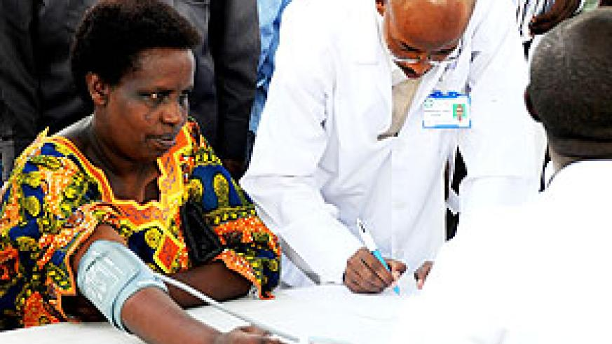 A patient taking a heart check up  (Photo; T. Kisambira)